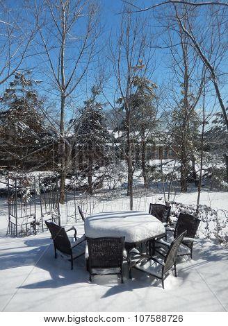 Backyard patio furniture in winter