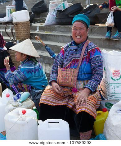 Vietnamese Hmong women selling traditional wine in canes