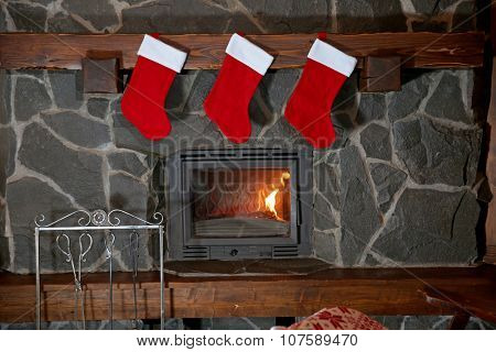 Christmas stockings hanging over the fireplace at midnight on Christmas Eve
