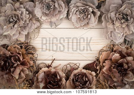 Christmas decorative flowers on the wooden background.