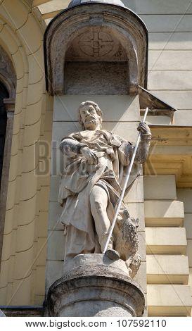 LJUBLJANA, SLOVENIA - JUNE 30: Saint John the Evangelist on the portal of Saint James church in Ljubljana, Slovenia on June 30, 2015