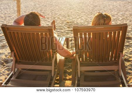couple sitting on the lounge chairs