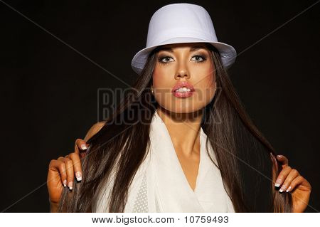 Attractive brunette woman in white hat