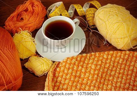 Woolen Yarn, Knitting,cup Of Tea, Glasses And Measuring Tape On Wooden Background.