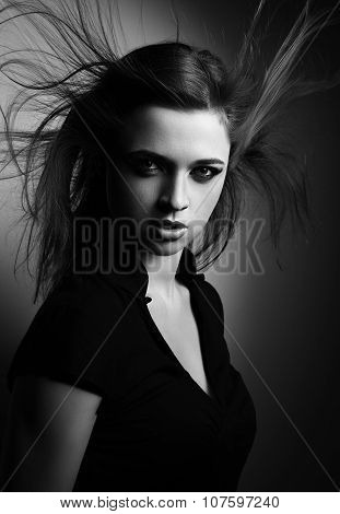 Wild Expressive Woman With Wind Hairstyle And Vamp Look On Dark. Mystic Portrait. Black And White