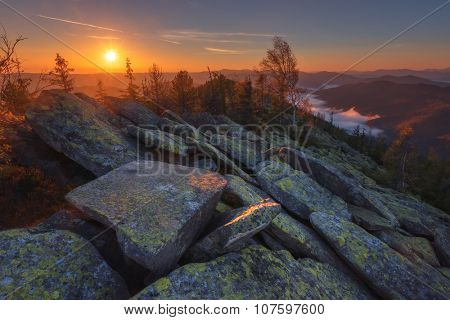 View of the stony hills glowing by evening sunlight. Dramatic autumn scene. Yavirnuk ridge, Carpathians, Ukraine, Europe.