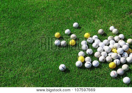 Golf balls on green golf course