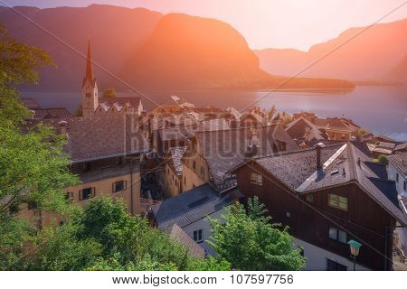 Sunny summer day in the Hallstatt village in the Austrian Alps. Maria am Berg church and Hallstattersee lake, Austria, Europe.