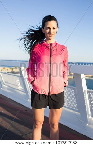 Beautiful fit woman resting after evening run in the fresh air during recreation time