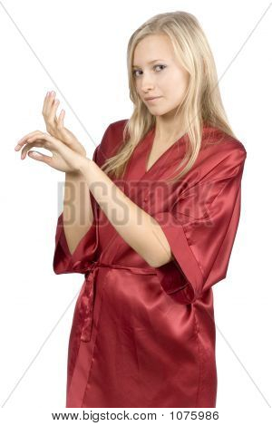 Young Woman Dressed Red Bathrobe With Cream On Her Hands