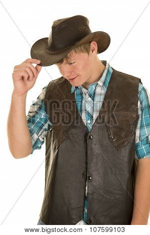 Young Cowboy In Vest Touch Hat Look Down