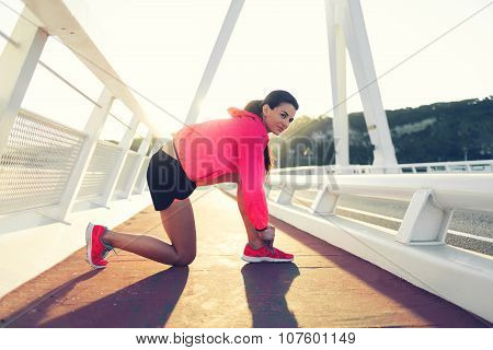 Athletic woman resting after fitness training outdoors during recreation time