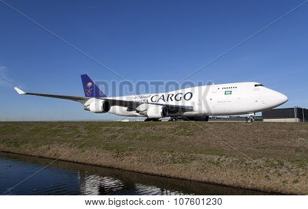 Big white cargo plane on a blue sky