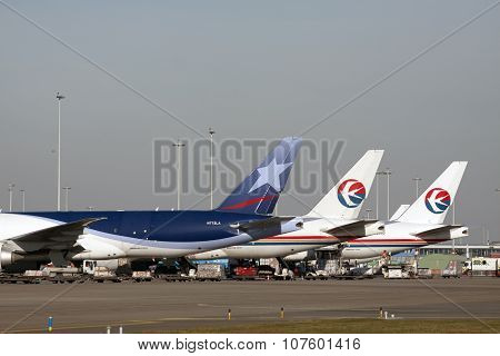 Three boeing cargo planes 777 in a Row.
