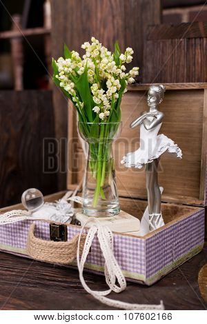 Lily on the valley and ballerina figure decor composition