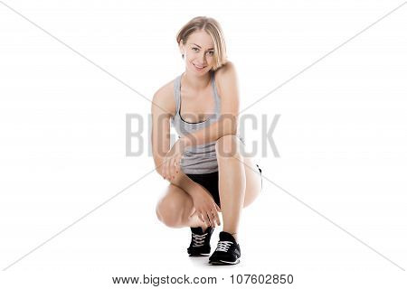 Sporty Woman Squatting