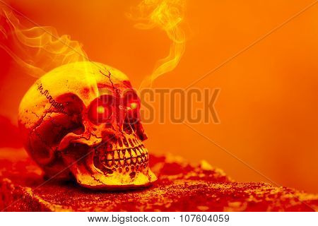 Abstract Skull In Orange Tone With Eye Shining Light And Smoke.