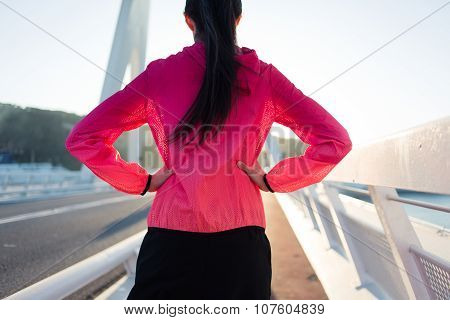 sporty woman relaxing after her fitness training in the fresh air during free time