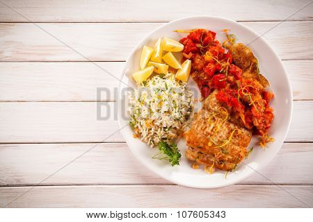 Fish dish - fried fish fillet white rice and vegetables