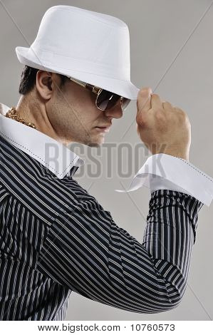 Handsome man in white hat