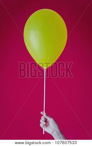 Hand Holding Balloon