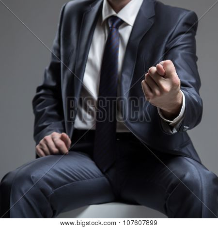 Businessman in Blue Suit Show Fig Sign. Concept About Angry or Furious