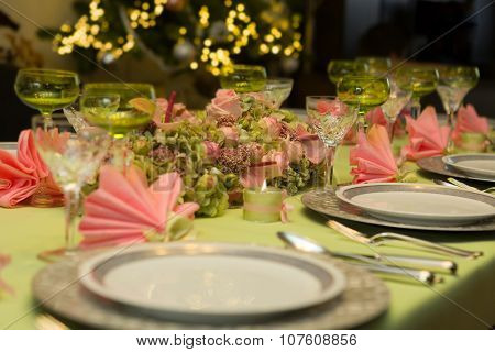 Festive Christmas table in soft pastel colors pink and green
