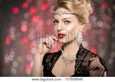 High-fashion Model Girl Beauty Woman high fashion Vogue Style Portrait fashionable Luxury lady jewelry diamond necklace Stylish Makeup Make up Perfect skin red lips blurred lights Bokeh backlight