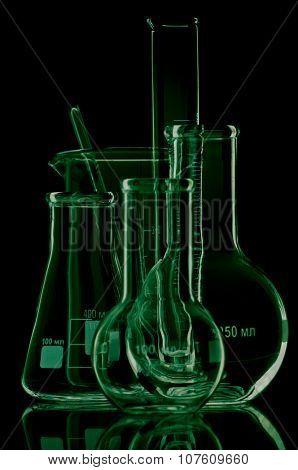 Laboratory glassware for liquids on black background