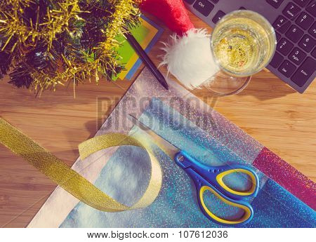 office desk with christmas accessories, wrapping paper for presents and stationery, view from above