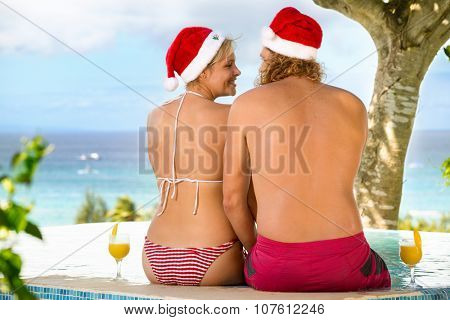 Romantic couple tropical on Christmas holiday, smiling and looking at each other