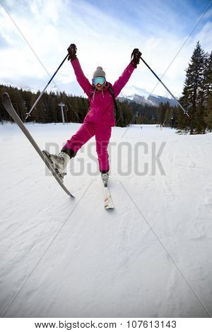 Happy woman on skis, winter vacation