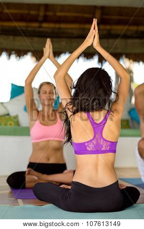 Yoga instructor showing exercise during yoga class