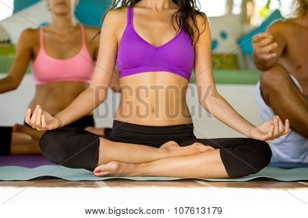 Close up of woman meditating in a lotus yoga position
