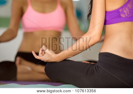 Detail of people in Yoga lotus position, yoga concept