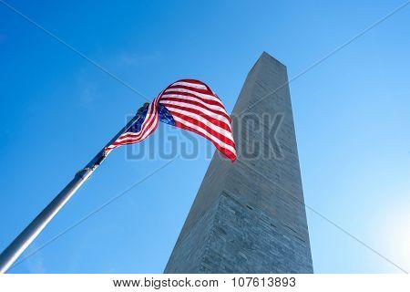 The Washington Monument and an US flag