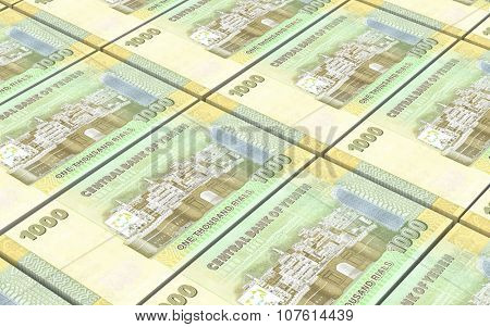 Yemeni rials bills stacked background. Computer generated 3D photo rendering.