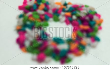 Blurred abstract background of colorful stones in circle/round pattern