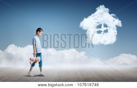 Boy with bear toy