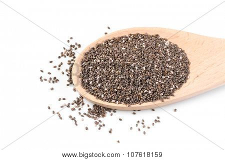 Chia seeds in a wooden spoon isolated on a white background.