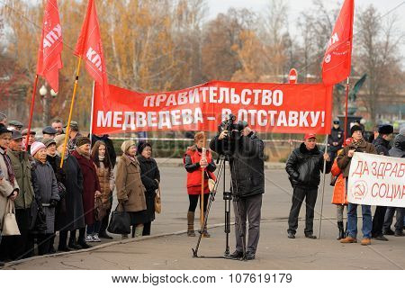 Orel, Russia - November 7, 2015: Communist Party Meeting. Red Banner, Red Flags, Tv Cameraman