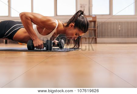 Strong Young Woman Doing Push-ups
