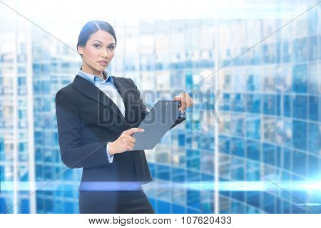 Portrait of business woman with black folder, blue background. Concept of leadership and success