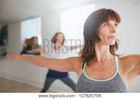 Woman Doing The Warrior Pose During Yoga Class