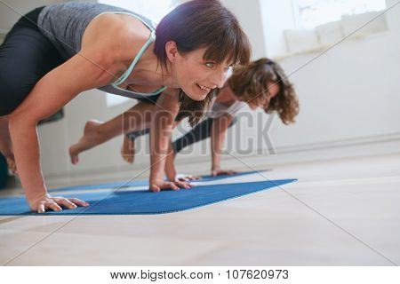 Women Doing Yoga Handstand - Bakasana