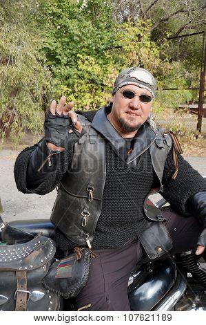 Biker In Black Clothes