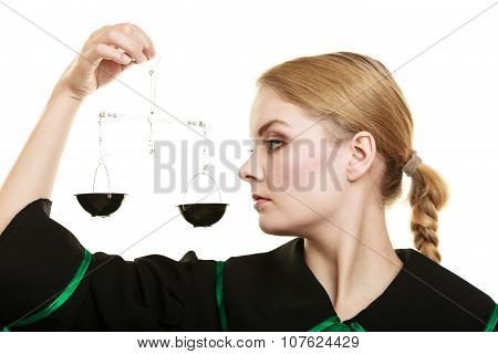 Woman Barrister Holding Scales.
