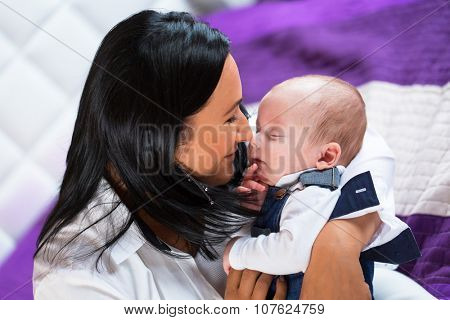 Mother cuddling little baby boy