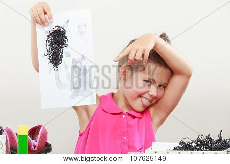 Little Girl Draw In The Classroom
