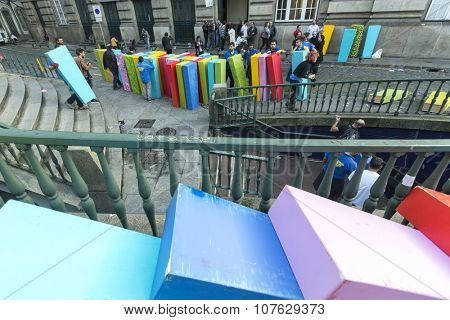 PORTO, PORTUGAL - SEP 8, 2015: Unidentified participants of action the Domino Effect , in the centre of the old town, near the railway station.